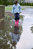 Kayla Standing In Puddle