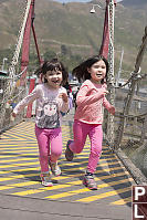 Girls Running On Bridge