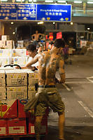 Tatoo Man Loading Boxes