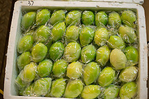 Cooler Of Green Plums