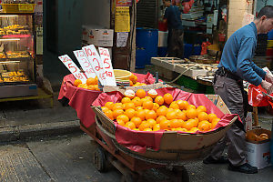 Oranges For Sale On Mobile Cart