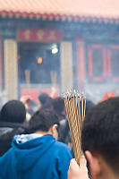 Holding AHand Full Of Incense