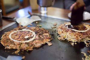 Painting Sauce On Okonomiyaki
