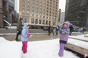 Claira And Nara Playing In Downtown Snow