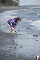 Nara Digging With Shovel At Beach