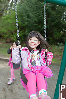 Happy Claira On Swing