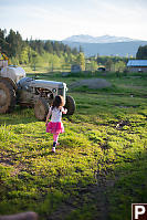 Claira Walking Past Tractor
