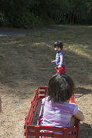 Claira Pulling Her Sister In Wagon