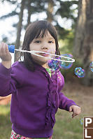 Claira Blowing Bubbles