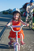 Claira Riding With Training Wheels