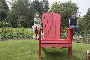 Sitting On Arms Of Giant Chair