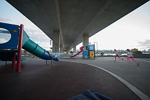 Kids Running Under Bridge