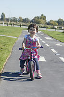 Claira Scooting On Her Strider
