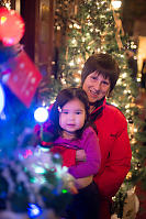 Nara And Grandma In Front Of Christmas Tree