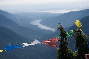 Budhist Prayer Flags With AView Of Vancouver