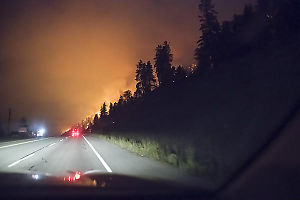 Driving Forest Fire Lit Road