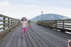 Nara And Claira On Pier Running