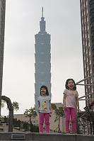 Kids With Taipei 101 Behind