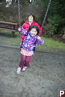 Nara On The Swing With Grandma Behind